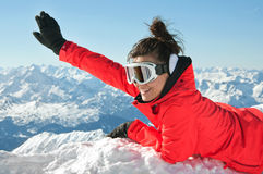 Girl waving from top of Alps with a huge smile Royalty Free Stock Photos