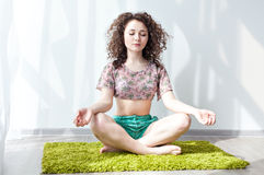 Girl with wavy engaged in stretching and yoga Stock Photography