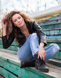 Girl with wavy hair on   street Royalty Free Stock Image
