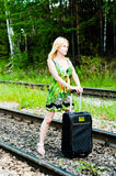 The girl on the way. Girl standing in the middle of railroad tracks blocking the path Royalty Free Stock Image