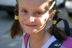 Girl  on the way to school. Royalty Free Stock Photos