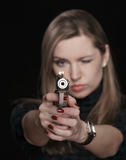 The girl with the weapon Stock Images