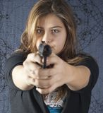 Girl with a weapon. On abstract background Stock Photos