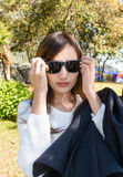 Girl wear black sunglasses Royalty Free Stock Images