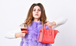 Girl wear fashion fur vest while posing with bag. Luxury store concept. Elite fashion clothes. Lady likes shopping. Designer clothing luxury fashion boutique stock photo