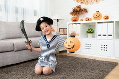 Girl wear pirate costume and holding a lantern Stock Photos