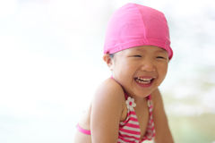 Girl wear swimsuit play happily Royalty Free Stock Photos