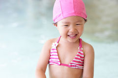 Girl wear swimsuit play happily Stock Image
