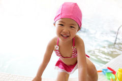 Girl wear swimsuit play happily Royalty Free Stock Photo