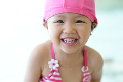 Girl wear swimsuit play happily Stock Photography