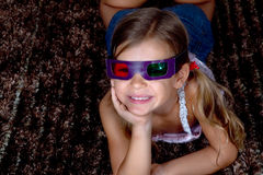 Girl wearing 3D glasses Royalty Free Stock Photo