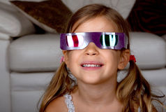 Girl wearing 3D glasses Stock Image