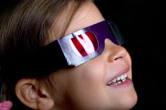 Girl wearing 3D glasses Royalty Free Stock Photos