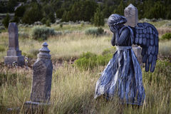 Girl wearing an angel costume in an old grave yard. Girl wearing a home made life like angel costume in an old grave yard stock image