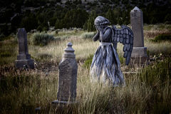 Girl wearing an angel costume in an old grave yard Stock Images