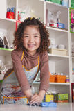 Girl Wearing Apron and Playing with Clay Stock Image