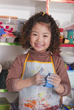 Girl Wearing Apron and Playing with Clay Stock Photos