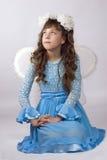 Girl wearing artifical wings Stock Image