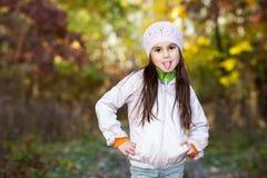 Girl wearing a beret showing tongue Royalty Free Stock Image