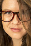 Girl wearing big glasses hair over one eye Royalty Free Stock Photo
