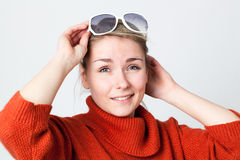 Girl wearing big white sunglasses over head enjoying winter sun Stock Photo