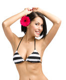 Girl wearing bikini and flower in hair Royalty Free Stock Photo