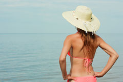 Girl wearing bikini and hat. And posing on beach royalty free stock images