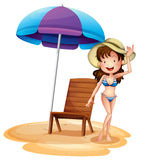 A girl wearing a bikini beside a summer chair and umbrella Stock Photography