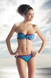 Girl wearing bikini in summer color Stock Images
