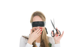 Girl wearing black band and holding scissors royalty free stock images