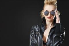 Girl wearing black leather jacket Stock Image