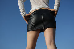 Girl wearing a black skirt Stock Photos