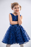 Girl wearing  blue dress Royalty Free Stock Images