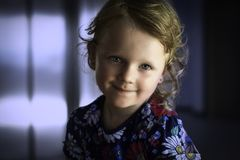 Girl Wearing Blue, White, and Red Floral Top royalty free stock images