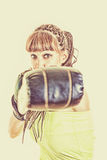 Girl wearing boxing gloves ready to fight and punching or hittin Stock Photos