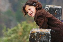 Girl Wearing Brown Coat Leaning On Concrete Pillar Royalty Free Stock Photography