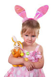 Girl wearing bunny ears and holding easter bunny. Happy Easter. royalty free stock photo
