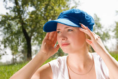 Girl wearing a cap. Pretty girl wearing a cap and protecting her hair form the sun Royalty Free Stock Image