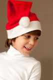 Girl wearing christmas cap. Cute smiling little girl wearing christmas hat studio shot Royalty Free Stock Photography