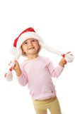 Girl wearing christmas hat. Little girl wearing christmas hat Royalty Free Stock Images