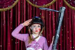 Girl Wearing Clown Make Up Holding Large Gun Royalty Free Stock Photos