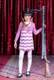 Girl Wearing Clown Make Up Holding Large Gun Stock Photography