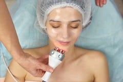 Girl wearing collagen mask. Royalty Free Stock Image