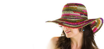 Girl wearing a colorful beach hat Stock Images