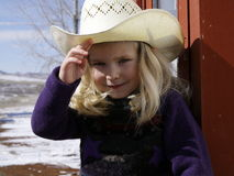 Girl wearing cowboy hat stock image