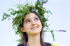 Girl wearing a crown of flowers Stock Photo