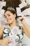 Girl wearing crown with lots Royalty Free Stock Photography