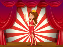 A girl wearing a crown at the stage Stock Photo