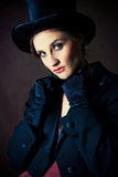 Girl wearing a cylinder hat Stock Image