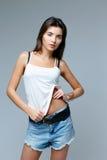 Girl wearing denim shorts Stock Image